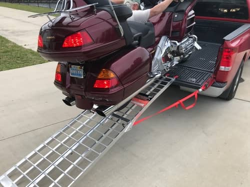 loading a motorycle in a pickup