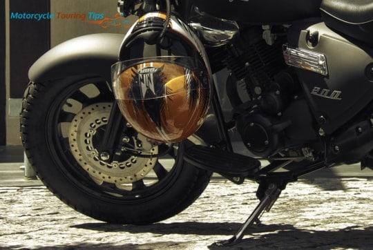 gold motorcycle helmet