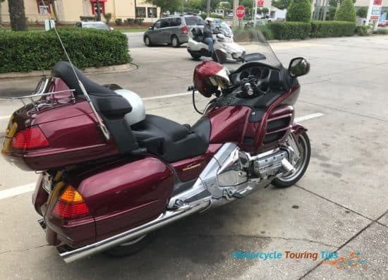 Goldwing parked at a gas station